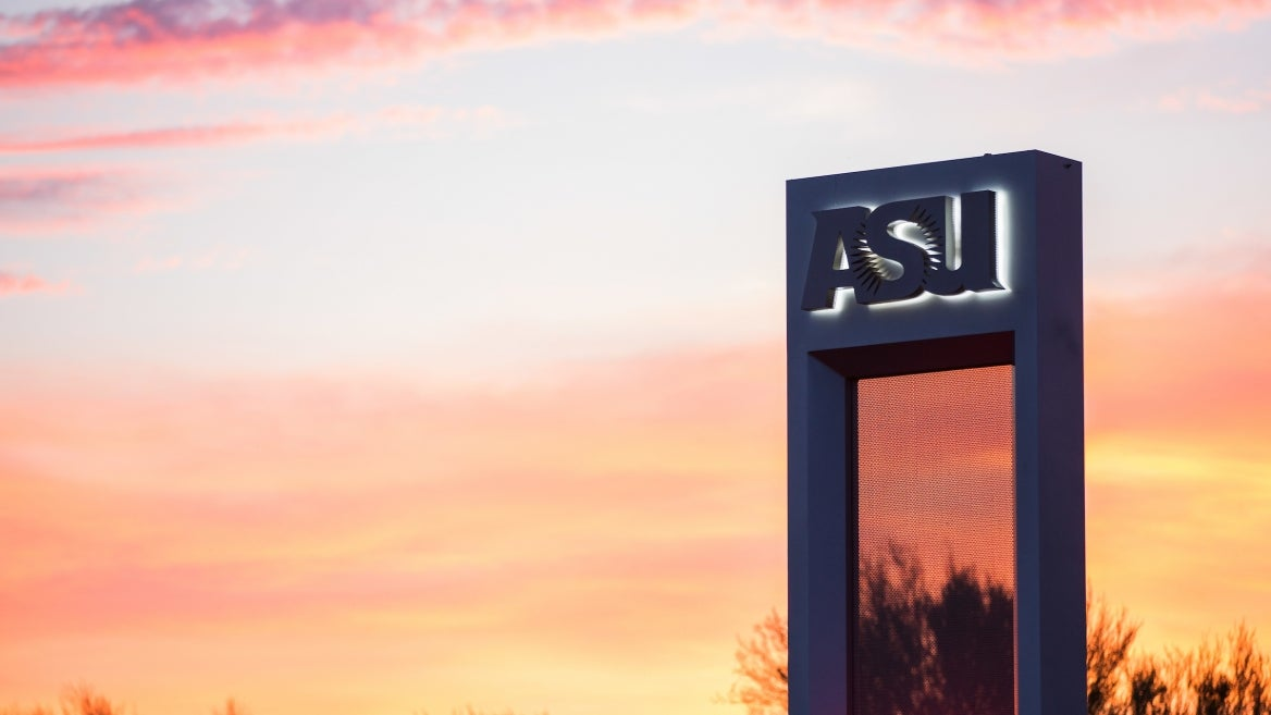 concrete pillar with ASU logo silhouetted by an Arizona sunset