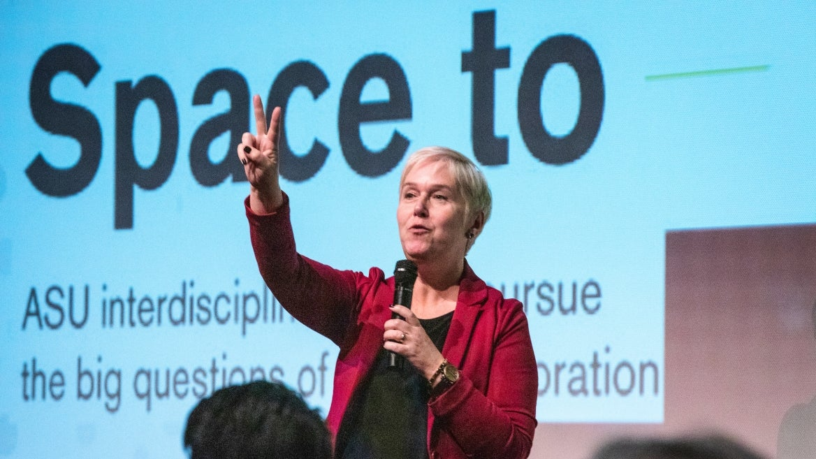 Lindy Elkins-Tanton speaks in front of a projector screen at an ASU Space to Thrive space missions panel