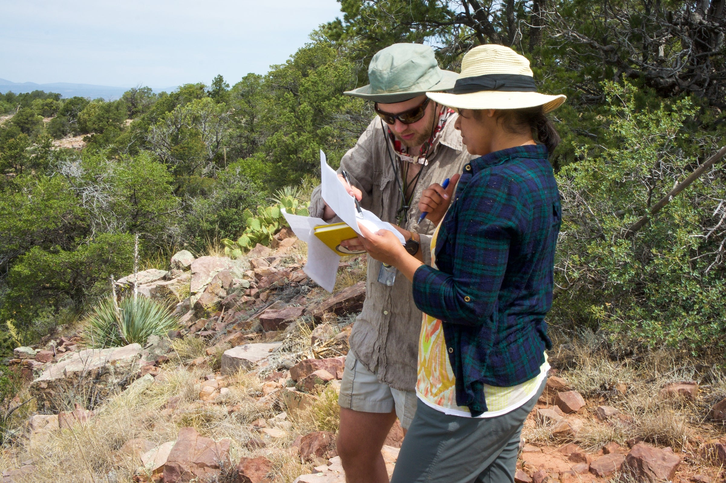 ASU graduate students consult coordinates to track a meteorite.