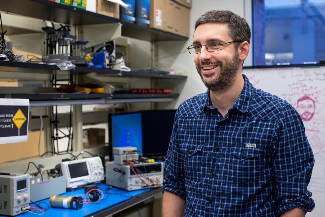 A spacecraft designer is interviewed in his lab
