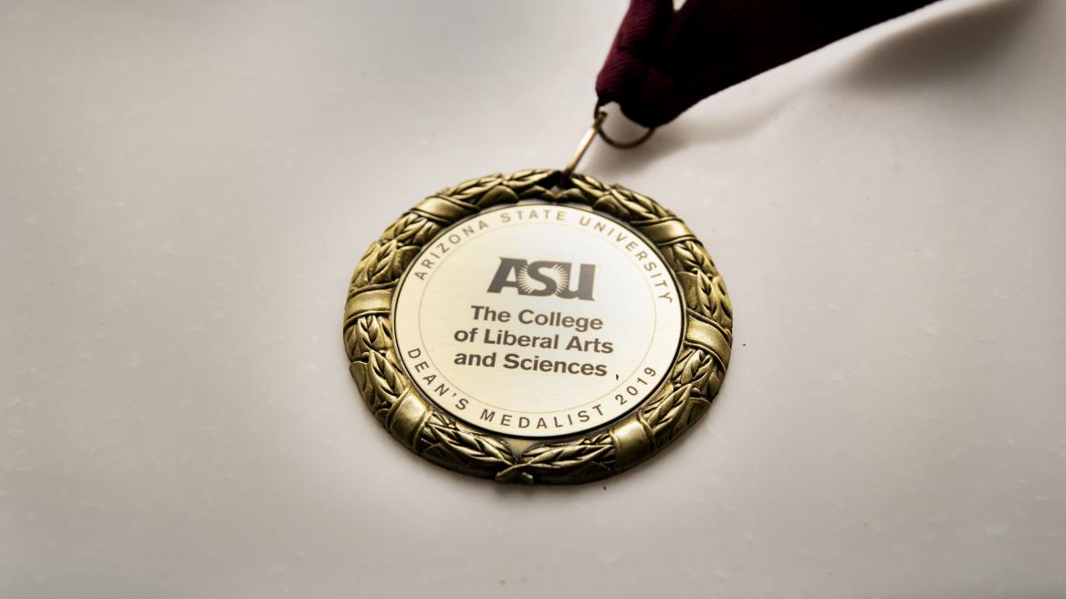 One of The College's 2019 Dean's Medal displayed.