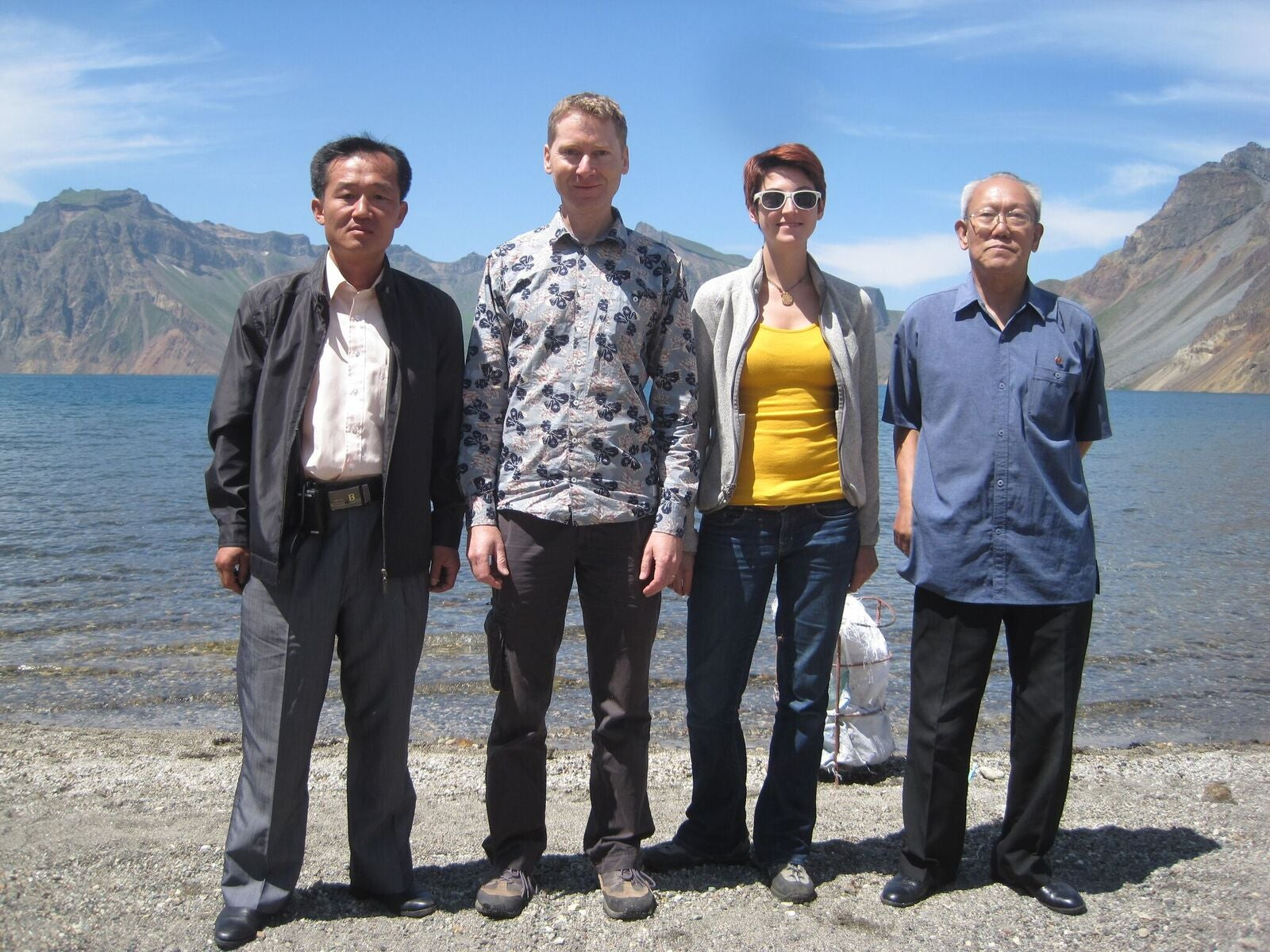 Researchers on the shore of Lake Chon
